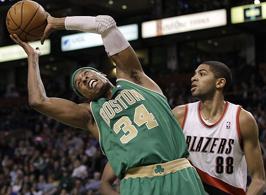Boston Celtics forward Paul Pierce (34) controls an offensive rebound in front of Portland Trail Blazers forward Nicolas Batum (88) during the second half of an NBA basketball game in Boston on Friday, March 9, 2012. The Celtics won 104-86.
