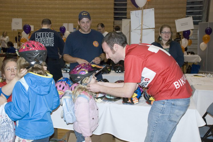 Children are fitted for bicycle helmets during the 2011 Community Wellness Festival in Baldwin City. This year's event is March 31 and helmets will be provided to children for free.