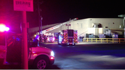 Firefighters remain at Berry Plastics, 2330 Packer Rd., after extinguishing a fire on Monday, March 12, 2012. The fire was reported around 7:00 p.m., and no one was injured.