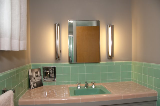 Photo the bathroom 39 s green tile was all the rage in for A bathroom item that starts with g