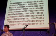 Shawn Bowen, 15, Lawrence, thinks hard as he tries to recite pi during a Pi Day celebration Wednesday at Theatre Lawrence. The event featured music, comedy skits, an auction benefiting the Douglas County Science Fair and a pie contest.
