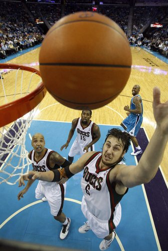 Milwaukee Bucks forward Drew Gooden, left, Milwaukee Bucks shooting guard John Salmons (15) and Milwaukee Bucks center Andrew Bogut, of Australia, (6) reach for a rebound over New Orleans Hornets forward David West in the first half of an NBA basketball game in New Orleans, Wednesday, Oct. 27, 2010.