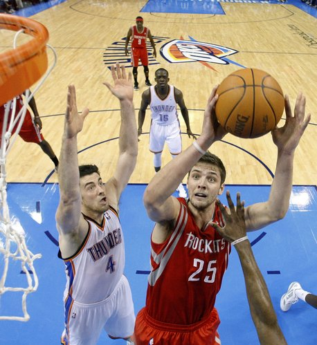 Houston Rockets forward Chandler Parsons (25) shoots in front of Oklahoma City Thunder center Nick Collison(4) in the second quarter of an NBA basketball game in Oklahoma City, Tuesday, March 13, 2012.