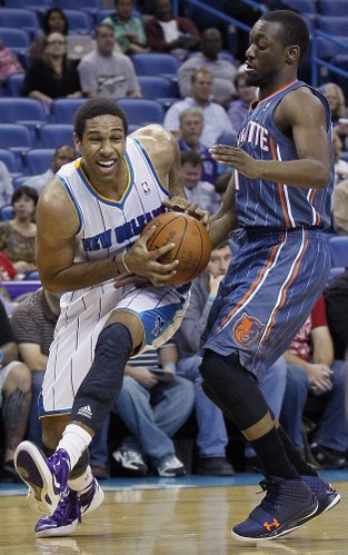 New Orleans Hornets shooting guard Xavier Henry (4) works around Charlotte Bobcats point guard Kemba Walker (1) in the first half of an NBA basketball game in New Orleans, Monday, March 12, 2012.