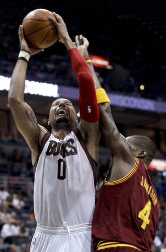 Milwaukee Bucks' Drew Gooden (0) goes up for a shot against Cleveland Cavaliers' Antawn Jamison (4) during the second half of an NBA basketball game Wednesday, March 14, 2012, in Milwaukee. The Bucks won 115-105.