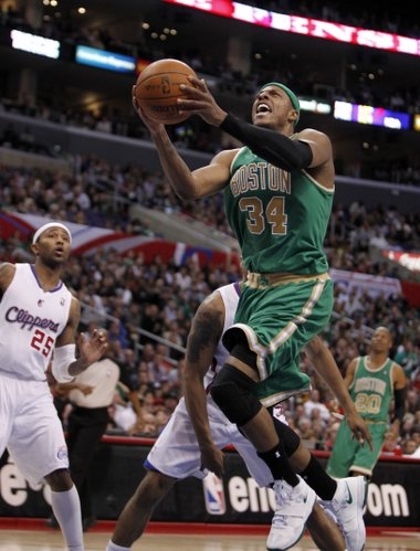 Boston Celtics forward Paul Pierce (34) goes to the basket as Los Angeles Clippers point guard Mo Williams looks on in the second half of an NBA basketball game in Los Angeles on Monday, March 12, 2012. Celtics won 94-85.