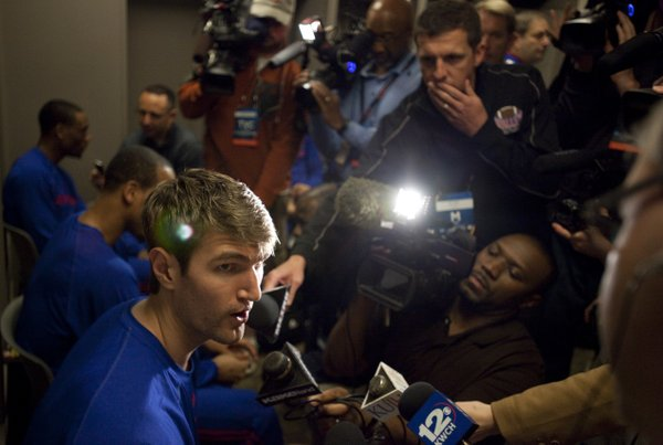 Kansas center Jeff Withey answers questions in the team's locker room prior to taking the court for practice at Century Link Center in Omaha.