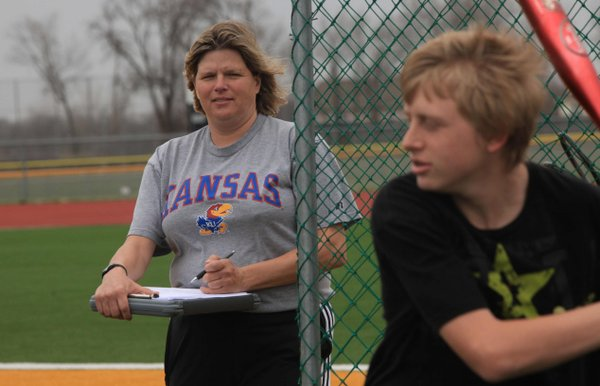 Susan Mayberry 47, a health and physical educational teacher at Basehor-Linwood High School, works with a class outside on Thursday, March 15, 2012. Mayberry was among 40 teachers who completed a heart health program at Kansas University Hospital last year. She said the program forced her to revisit the factors that put her at risk for heart disease, and one of those factors was her poor diet. The program provided one-on-one counseling and since then, she said she has improved her eating habits.