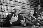 Former FBI officials, Mark Felt, left, and Edward S. Miller, appear at a news conference, April 15, 1981 after learning that President Reagan had pardoned them from their conviction of unauthorized break-ins during the Nixon administration's search for opponents during the Vietnam War. Felt is better known as Deep Throat, the anonymous source that helped two Washington Post reporters investigate the Watergate break-ins. A new book published by University Press of Kansas explains how Felt went from FBI company man to whistle-blower.