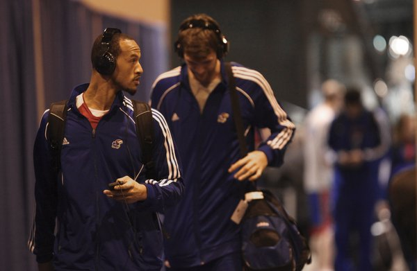 Kansas guard Travis Releford and center Jeff Withey make their way into the arena for interviews and practice on Saturday, March 17, 2012 at CenturyLink Center in Omaha.