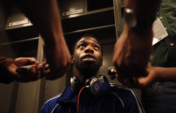 Kansas guard Elijah Johnson responds to questions from media members in the team locker room before practice, Saturday, March 17, 2012 at CenturyLink Center in Omaha.