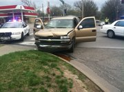 This Chevrolet truck struck a car at the intersection of 25th and Iowa streets at about 3:30 p.m. Sunday. The four occupants of the truck were not transported to hospital, though the two occupants of the other car were — one by LifeStar ambulance to KU Med.