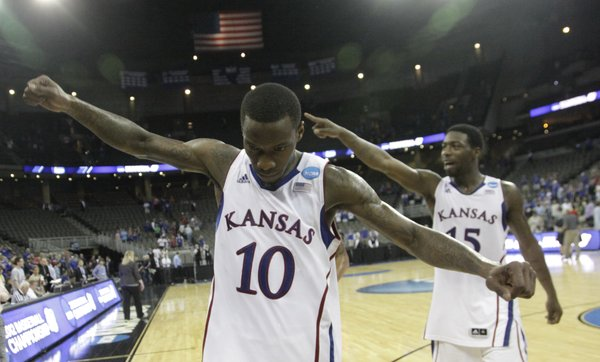 Tyshawn Taylor (10) and Elijah Johnson (15) walk off the court and acknowledge the crowd after KUÕs 63-60 win over the Purdue Boilermakers. KU will advance to the Sweet Sixteen game against North Carolina State, Friday, March 23, in St. Louis.