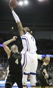 Kansas forward Thomas Robinson grabs a pass inside over Purdue forward Robbie Hummel during the first half on Sunday, March 18, 2012 at CenturyLink Center in Omaha.