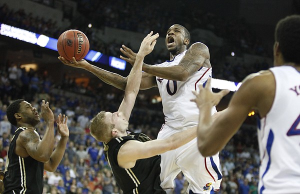 Kansas forward Thomas Robinson draws a foul on a shot from Purdue forward Robbie Hummel during the second half on Sunday, March 18, 2012 at CenturyLink Center in Omaha.