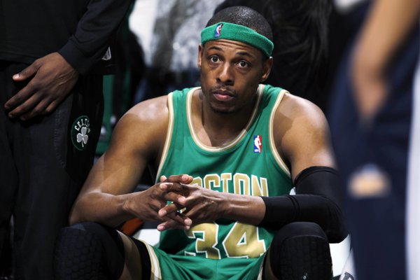 Boston Celtics forward Paul Pierce sits on the bench after fouling out late in the fourth quarter in the Denver Nuggets' 98-91 victory in an NBA basketball game in Denver on Saturday, March 17, 2012.