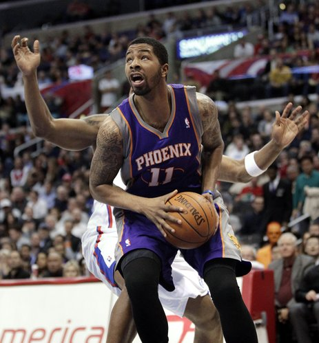 Phoenix Suns' Markieff Morris looks to shoot in front of Los Angeles Clippers' Bobby Simmons during the first half of an NBA basketball game in Los Angeles, Thursday, March 15, 2012.