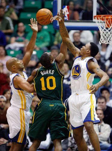 Utah Jazz guard Alec Burks (10) has a shot blocked by Golden State Warriors forward Brandon Rush (4) as Warriors forward Richard Jefferson (44) assists with the defense during the first half of an NBA basketball game in Salt Lake City, Saturday, March 17, 2012.