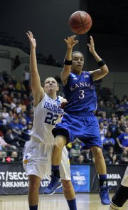 Kansas' Angel Goodrich (3) passes over Delaware's Lauren Carra (22) during the second half on Tuesday in Little Rock, Ark.