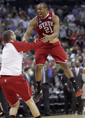 North Carolina State's C.J. Williams, right, celebrates the team's win over Georgetown in an an NCAA college basketball tournament third-round game Sunday, March 18, 2012, in Columbus, Ohio. N.C. State beat Georgetown, 66-63.