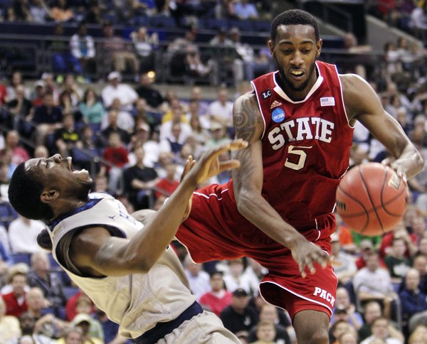 North Carolina State's C.J. Leslie, right, collides with Georgetown's Henry Sims during the second half of an NCAA college basketball tournament third-round game, Sunday, March 18, 2012, in Columbus, Ohio. NC State defeated Georgetown 66-63.