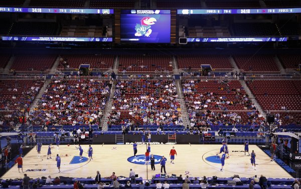 The Jayhawks take the court during a day of press conferences and practices at the Edward Jones Dome in St. Louis.