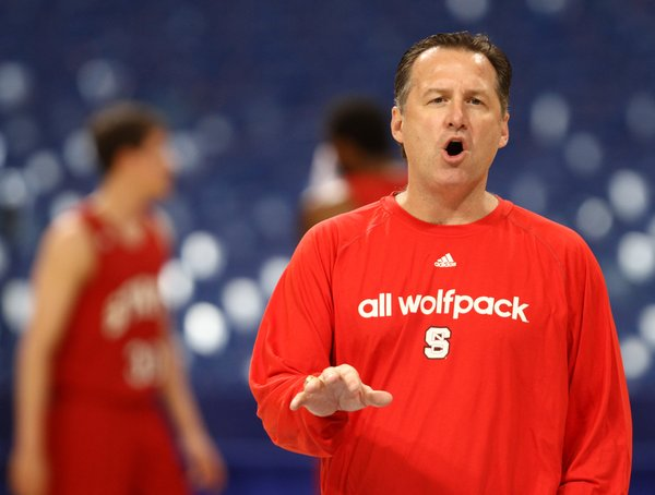 North Carolina State head coach Mark Gottfried directs his players during practice at the Edward Jones Dome in St. Louis.