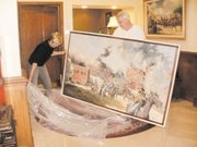 Connie Breidenthal (left) and Jamie Lavin, director of the Buttonwood Art Space and Kansas City Club, unpack a painting by Bonner Springs artist Ernst Ulmer in this 2010 file photo.