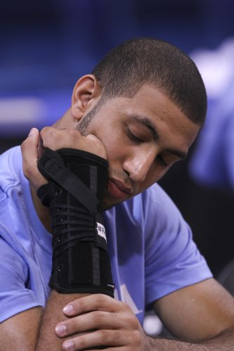 North Carolina guard Kendall Marshall wears a brace on his wrist  during practice at the Edward Jones Dome in St. Louis.