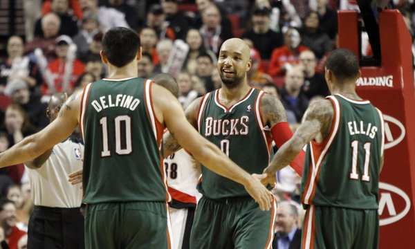 Milwaukee Bucks center Drew Gooden, middle, receives congratulations from teammates Carlos Delfino, left, and Monta Ellis after scoring during the second half of their NBA basketball game against the Portland Trail Blazers in Portland, Ore., Tuesday, March 20, 2012. Gooden scored 19 points as they beat the Blazers 116-87.