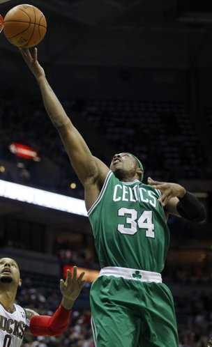 Boston Celtics' Paul Pierce (34) drives against Milwaukee Bucks' Drew Gooden, left, during the first half of an NBA basketball game on Thursday, March 22, 2012, in Milwaukee.