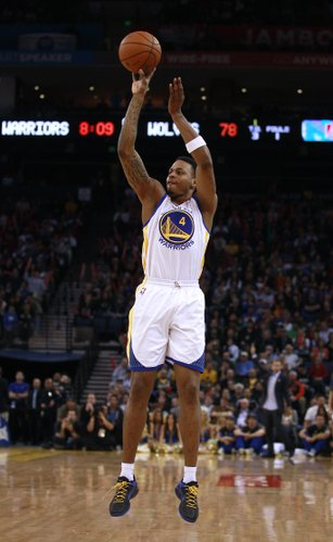 Golden State Warriors shooting guard Brandon Rush (4) is shown against the Minnesota Timberwolves in an NBA basketball game in Oakland, Calif., Monday, March 19, 2012.