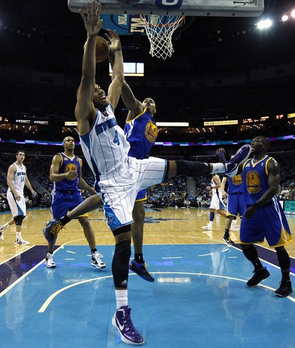 Golden State Warriors guard Brandon Rush (4) blocks a shot by New Orleans Hornets guard Xavier Henry (4) in the second half of an NBA basketball game in New Orleans, Wednesday, March 21, 2012. The Warriors won 101-92.