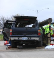 Two people were injured at Tee Pee Junction when a utility pole carried on a truck went through the windshield of the vehicle in which they were riding.