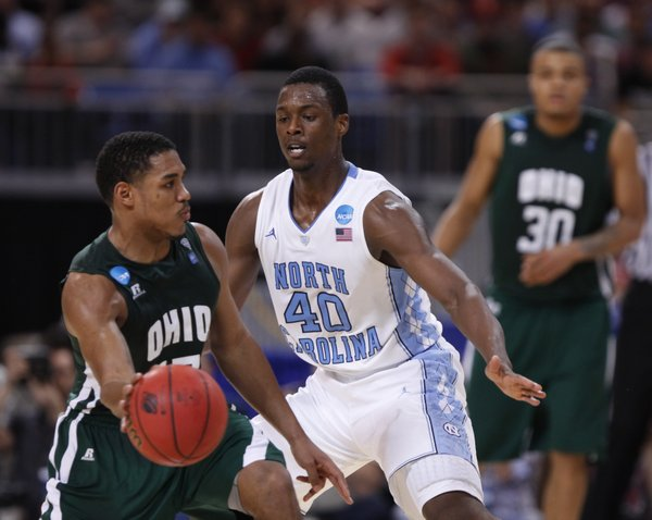 North Carolina forward Harrison Barnes defends against a pass from Ohio guard Nick Kellogg during the first half on Friday, March 23, 2012 at the Edward Jones Dome in St. Louis.