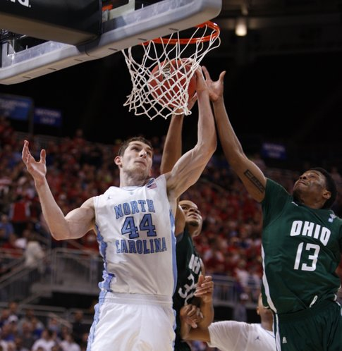 North Carolina forward Tyler Zeller pulls a rebound from Ohio defenders TyQuane Goard (32) and T.J. Hall during the second half on Friday, March 23, 2012 at the Edward Jones Dome in St. Louis.