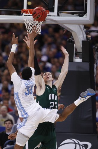 North Carolina forward John Henson puts up an off-balance shot over Ohio forward Ivo Baltic during the second half on Friday, March 23, 2012 at the Edward Jones Dome in St. Louis.