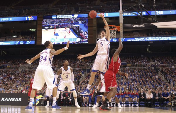 Kansas center Jeff Withey blocks a shot by North Carolina State forward Richard Howell during the second half on Friday, March 23, 2012 at the Edward Jones Dome in St. Louis.