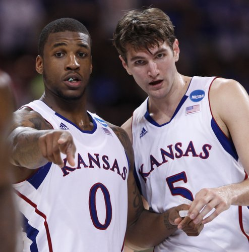 Kansas teammates Thomas Robinson and Jeff Withey talks strategy during the second half on Friday, March 23, 2012 at the Edward Jones Dome in St. Louis.