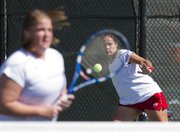 Kansas' Monica Pezzotti, right, hits a return while her doubles partner Dylan Windom waits at the net during their tennis match against Baylor Saturday, March 24, 2012 at the Jayhawk Tennis Center.