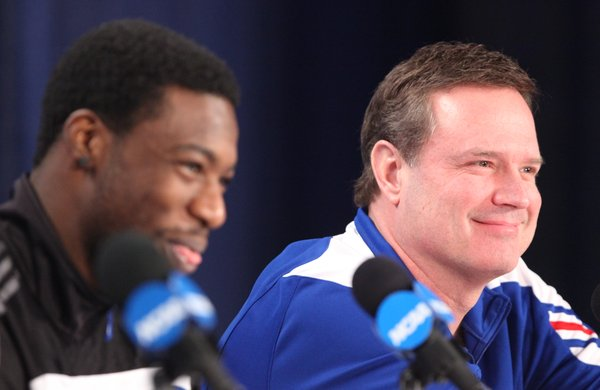 Kansas head coach Bill Self smiles next to Elijah Johnson as his players speak to his personality during a press conference on Saturday, March 24, 2012 at the Edward Jones Dome in St. Louis.