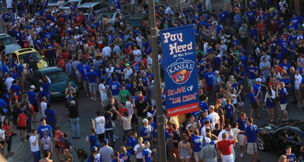 Hundreds of people poured onto Massachusetts Street on Sunday after Kansas defeated North Carolina to head to the Final Four in New Orleans next weekend. The Jayhawks beat the Tar Heels, a No. 1 seed, 80-67.