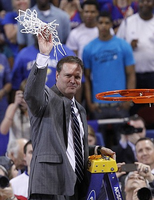 Kansas coach Bill Self holds the net after the last clipping after the Jayhawks' 80-67 win over North Carolina in St. Louis Friday, March 25, 2012. With the win, KU advances to the Final Four next weekend in New Orleans, Louisiana.