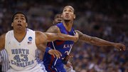 Kansas guard Travis Releford works for position against North Carolina players James Michael McAdoo, left, and Reggie Bullock during the first half on Sunday,  March 25, 2012 at the Edward Jones Dome in St. Louis.