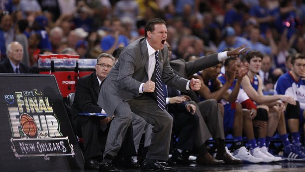 Kansas head coach Bill Self gets down to energize his defense against North Carolina during the first half on Sunday,  March 25, 2012 at the Edward Jones Dome in St. Louis.