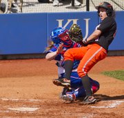 Oklahoma State's Tamara Brown tries to plow through Kansas catcher Lexi Bryant's tag at the plate during the final game of a three game series Sunday, March 25, 2012 at Arrocha Ballpark.Bryant held onto the ball and Brown was called out on the play.