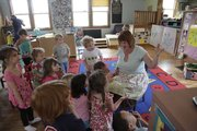 Laurie Dale Marshall, director of the Lawrence Community Nursery School, 645 Ala., reads to the children on March 27.