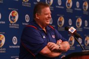 Kansas football coach Charlie Weis smiles big after talking about how it felt to be in Lawrence after the KU men's basketball Elite Eight win against North Carolina. Weis held a press conference for the start of spring football practice on Tuesday, March 27, 2012.