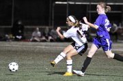 Lawrence High junior Elizabeth Burney takes a shot on goal against Baldwin girls soccer Tuesday, Mar. 27, 2012.