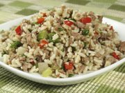 Dirty rice is usually flavored with vegetables and chicken.